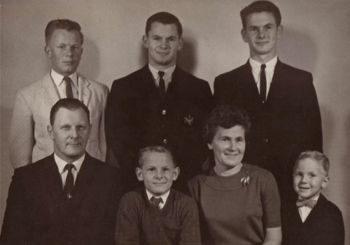 Dave is between his parents. His brother John is far right in the back row.