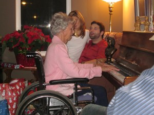 grandma plays for carol singing