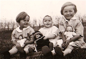 Here is Mom and her sisters with their dolls, probably around 1929. Look at those shoes.