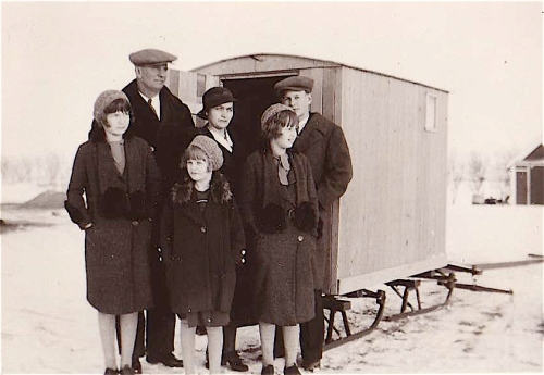 schmidt family with sleigh