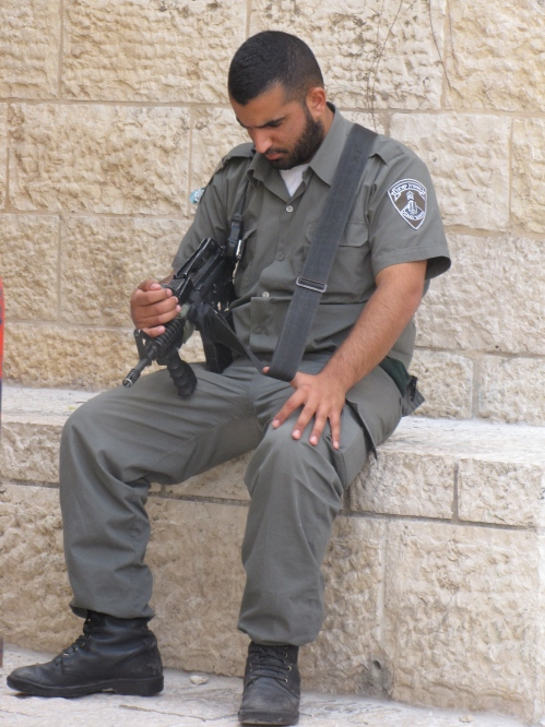 armed guard asleep in jerusalem