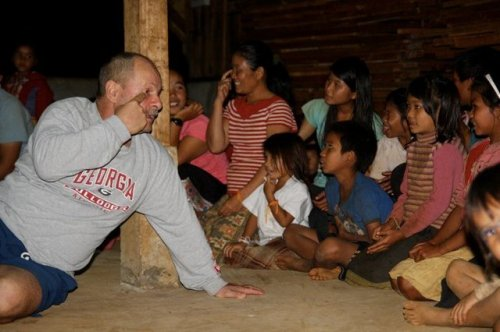 with children on bolaven coffee plantation in laos