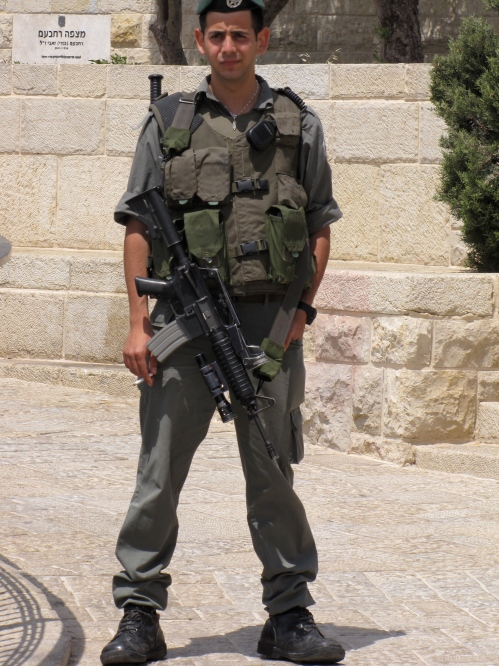 soldier with gun at the Mount of Olives