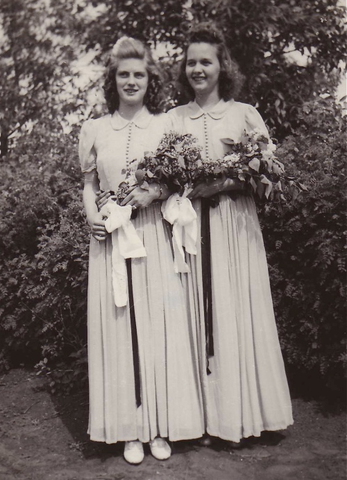 Dorothy and her best friend Mildred in graduation gowns they sewed themselves