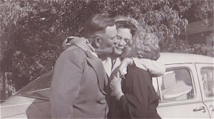 My grandma and grandpa kissing my mother good-bye as she leaves on her honeymoon