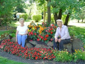 Mom and Dad in the flower garden of their country property