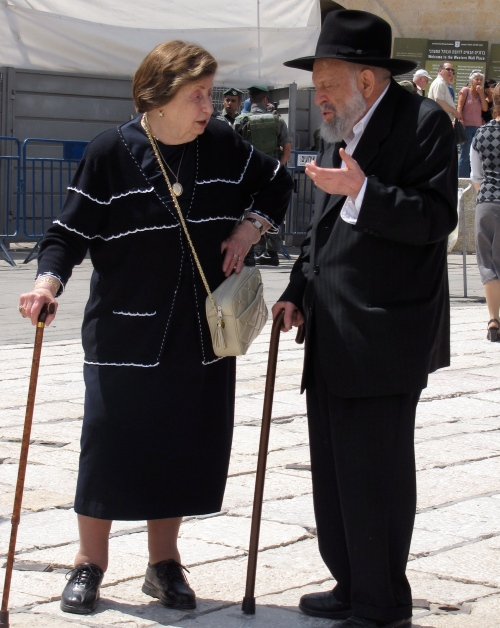 eldery man and woman at the wailing wall in jerusalem