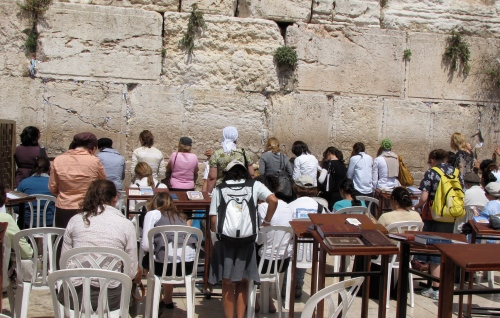 Women, including my students and I praying at the Wailing Wall in Jerusalem.