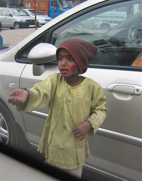 boy begging in dehli