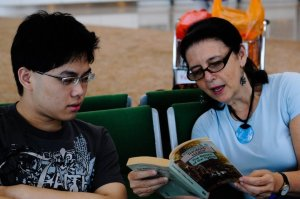 Me reading to one of my Hong Kong students in the airport