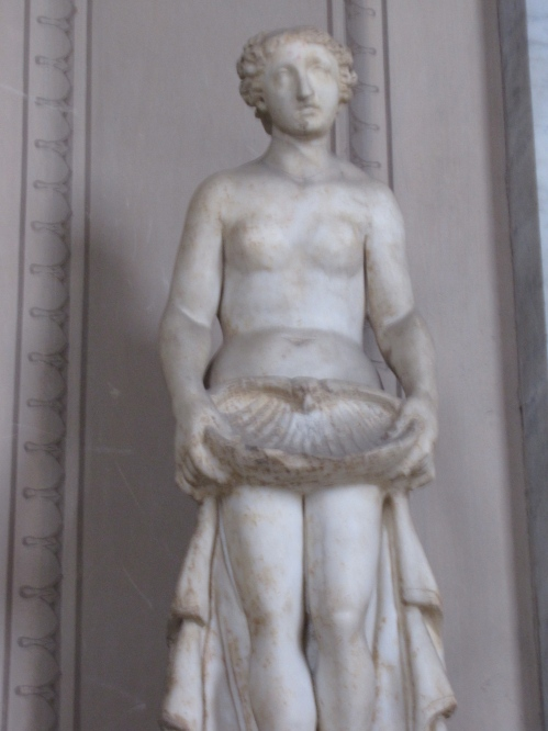 naked statue with seashell the vatican