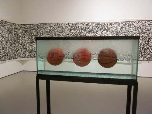 Three Ball 50/50 Tank by Jeff by Jeff Koons photographed at the MOMA in New York in 2012
