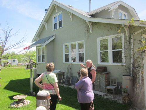 Getting a tour of Evelyn Richter's yard and heritage home