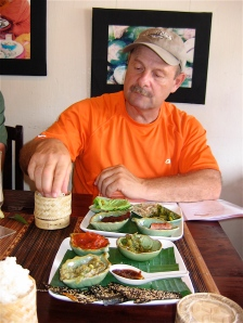 man eating sticky rice in tamarind restaurant laos
