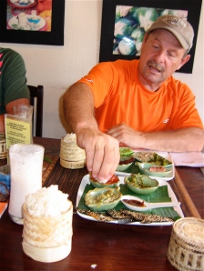 eating sticky rice and dipping it in laos