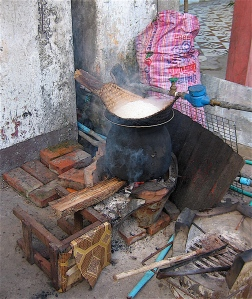preparing sticky rice in laos