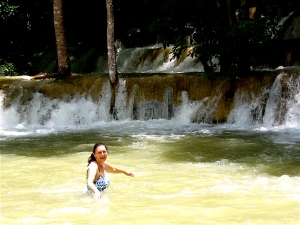 swimming in the tad se waterfall in laos