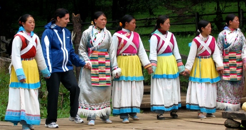 dancing with naxi women in yunnan province china