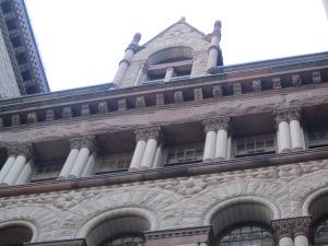 decorative panels around old city hall in toronto