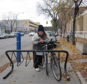 man at bike rack on freezing day