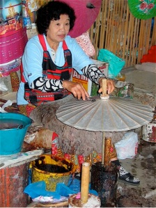 Woman making umbrellas for tourists in chiang mai
