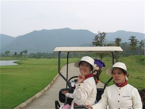 Female golf caddies in Chiang Mai