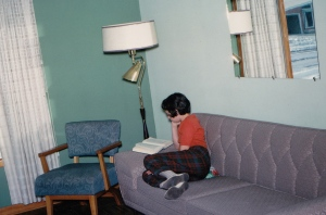 girl reading on the couch 1963