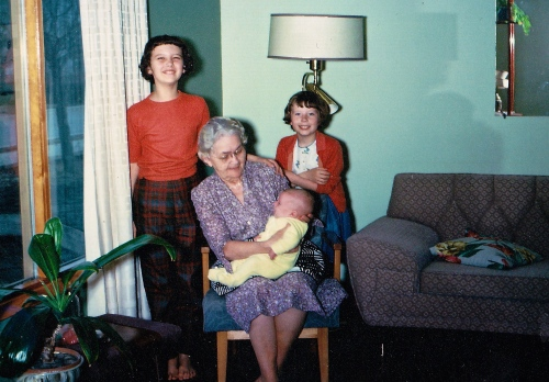 My sister and brother and I with my grandmother. Her arm was definitely healed enought to hold a baby.