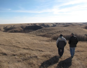 Dave and our guide Dave Neufeld walk towards the buffalo jump