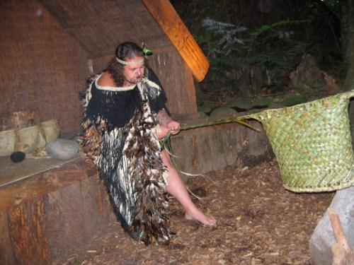 A Maori basket weaver demonstrates his craft