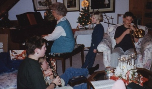 Mom on the piano with one grandson on clarinet and another on trombone