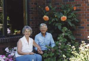 mom and dad in their flower garden