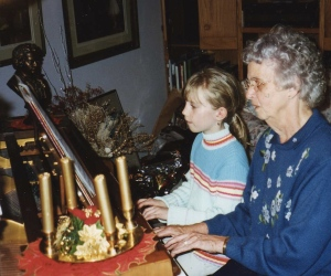 My Mom playing the piano with her granddaughter