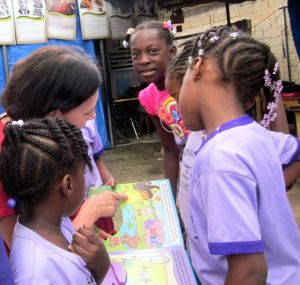 reading to kids in jamaican daycare