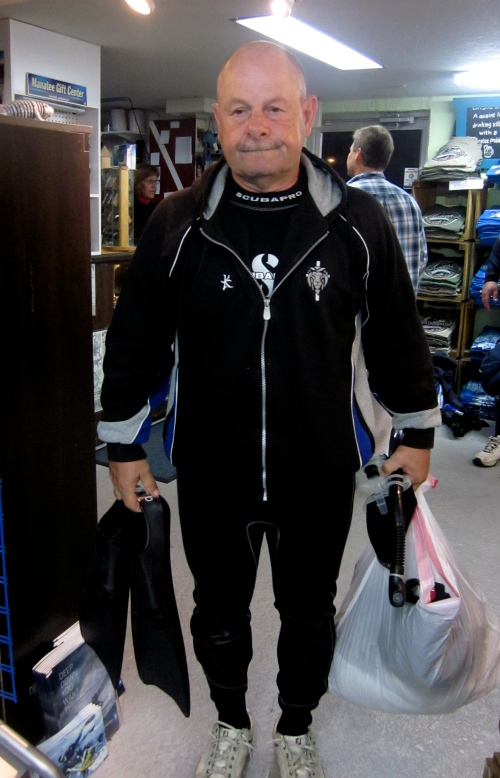 Dave gets suited up in the dive shop.
