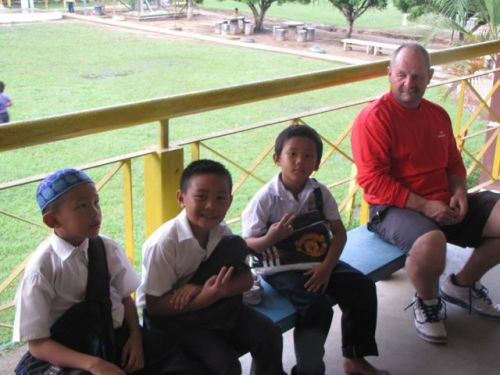 Dave with kids at Sanih's school