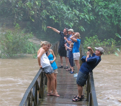 taking photo at waterfall in laos