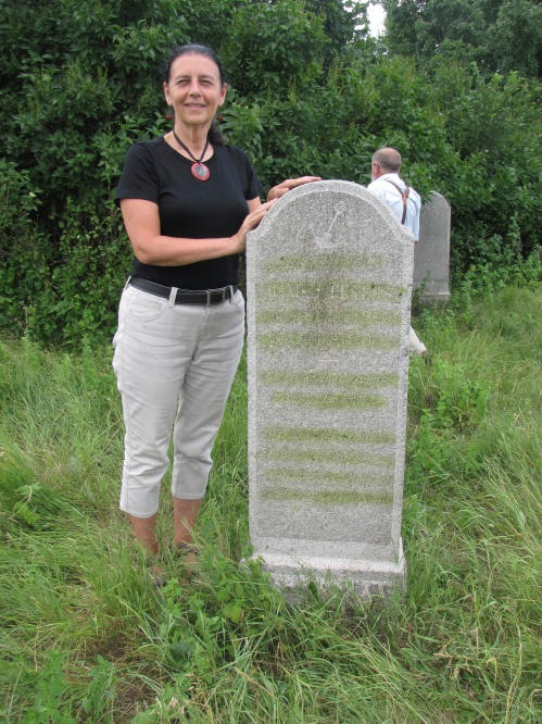 I stand beside the tombstone of the great, great grandfather Daniel Peters in Nikolaipol Cemetery Ukraine
