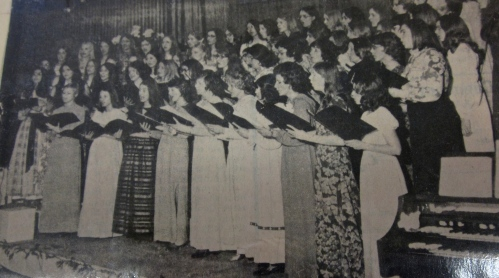Old and new members of the Treble Teens perform a number at the 1971 spring concert- I'm at the far end left in the second row wearing my highschool graduation dress and sporting my granny glasses