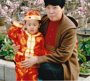 grandmother and grandchld in tiananmen square 2004