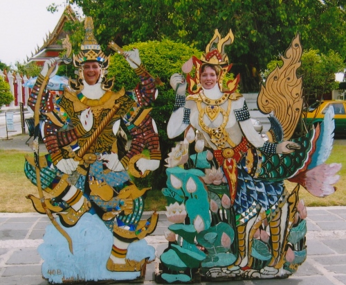 My friend Anna and I pose in cutouts at the Temple of Dawn