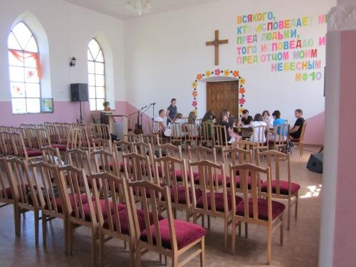 people meeting in church in peterhagen