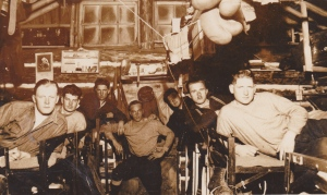 In the lumber camp bunk house. Dad's on the far left.