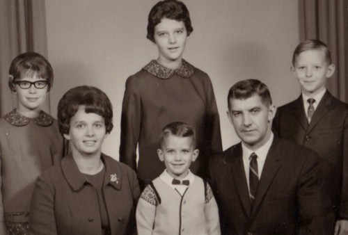 That's me in the back row with my family in the mid-sixties