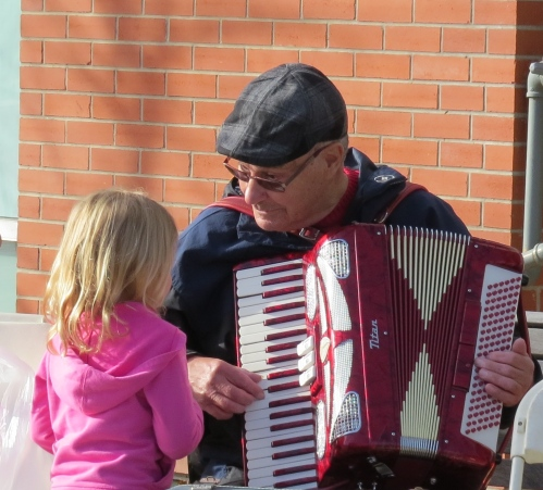 man, child accordion saskatoon farmers' market