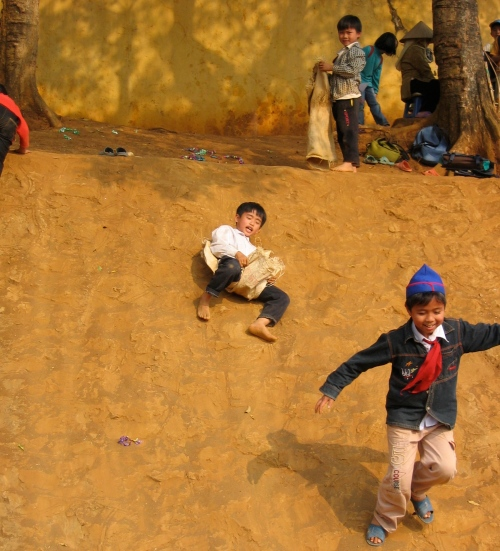 vietnamese boys sand sliding