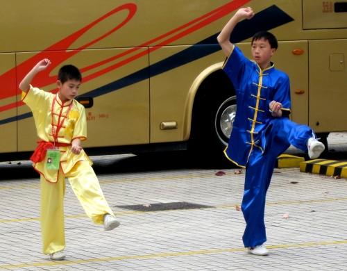 wu shu performers warming up