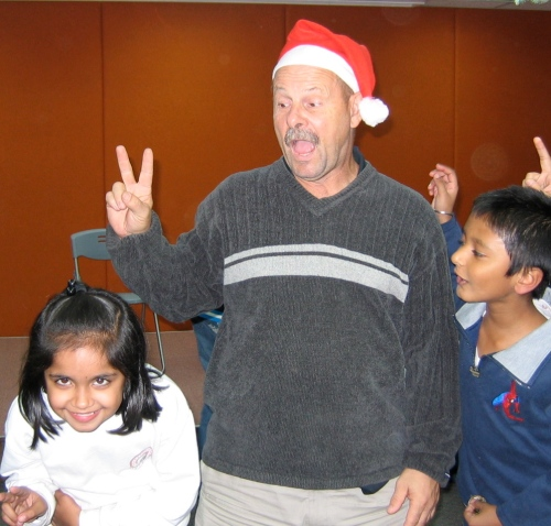 Dave plays Santa for refugee kids in Hong Kong