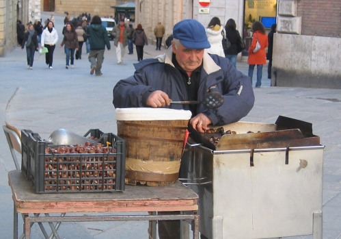 man selling chestnuts in florence