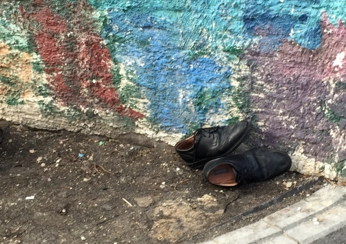 abandoned shoes on portage avenue